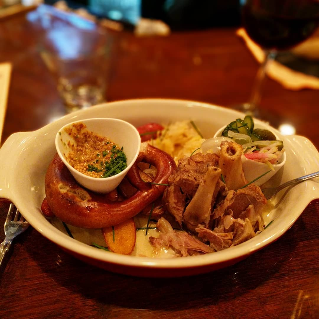 Choucroute Garnie. Smoked pork belly, potato sausage, slow roasted pork shank, apple-fennel kraut, crispy potato, porky pretzel, Dusseldorf mustard and a seasonal pickle. Delicious. #foodporn