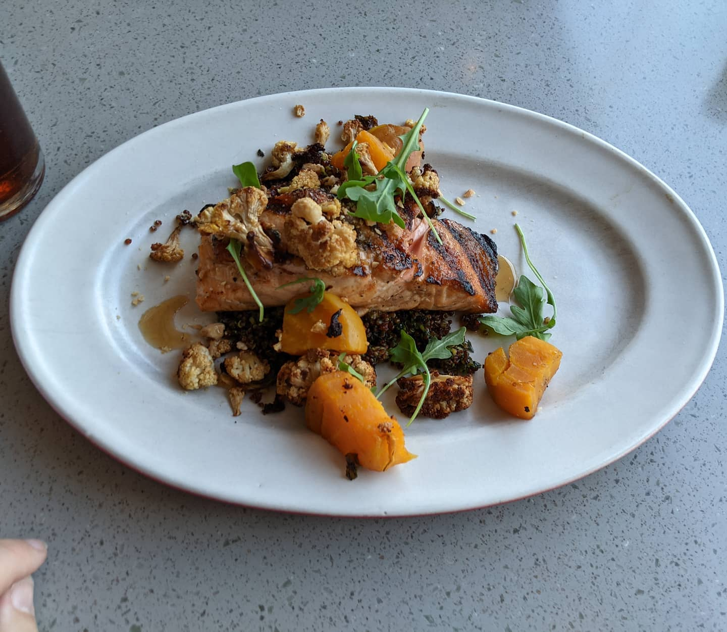 Tonight's #phoenix #foodporn is a simple salmon filet over pesto quinoa. And a beer.