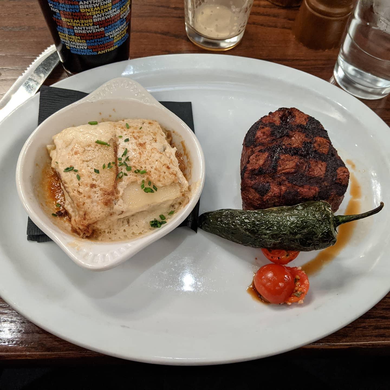 Oklahoma #foodporn. 8oz filet with au gratin potatoes. And a Guinness... #okc