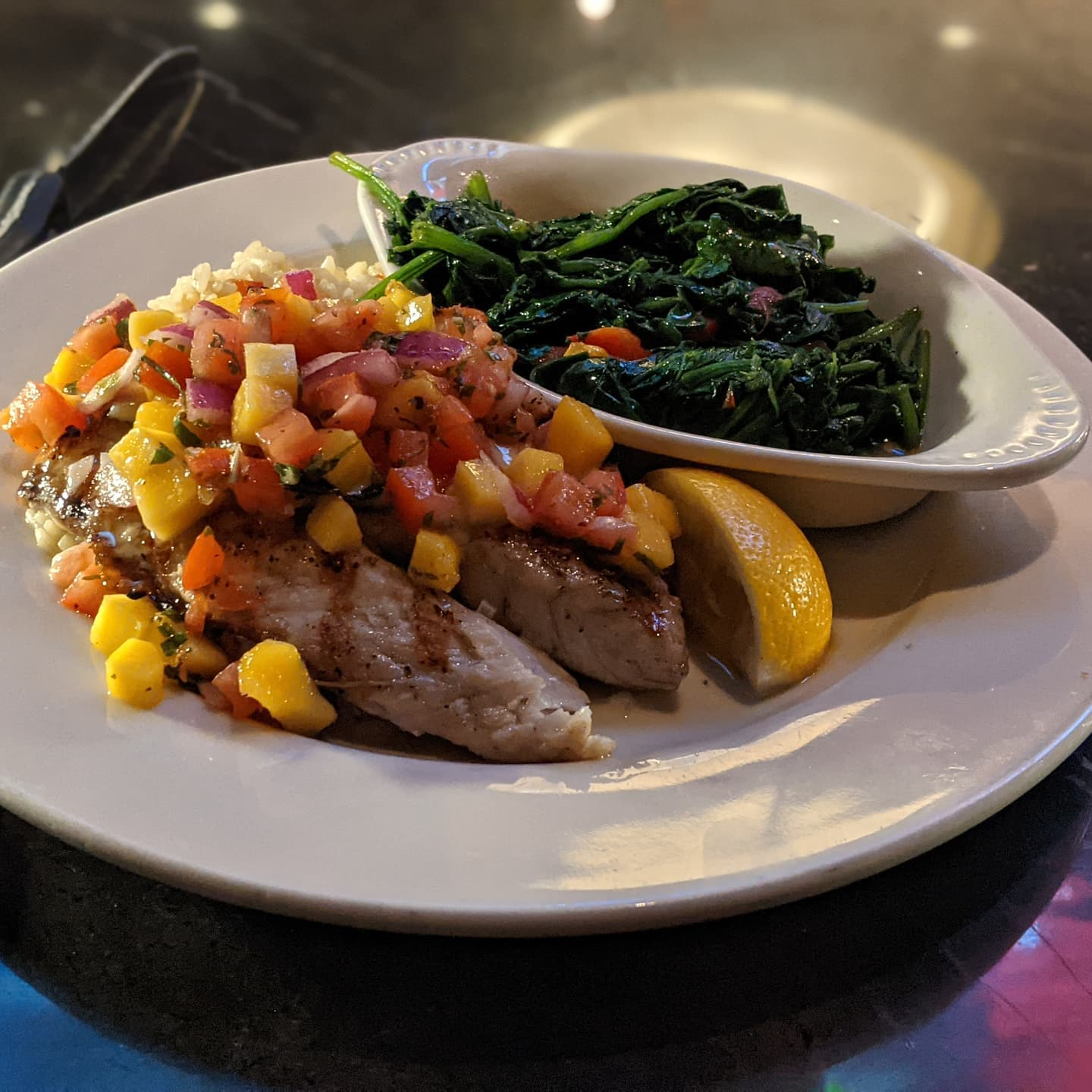 Semi normal #foodporn service resumed. Grilled barramundi with mango salsa and a side of sauteed spinach. And was delicious by the way!